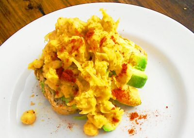 Avocado and scrambled chickpeas on toast breakfast at the Ad Astra Guesthouse