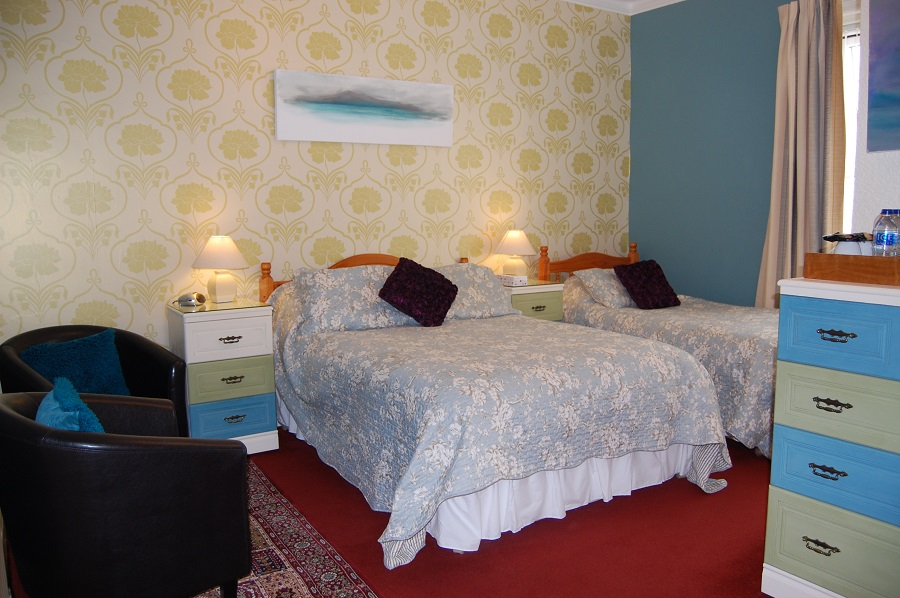 1st floor room sleeps maximum of three, double and single beds.